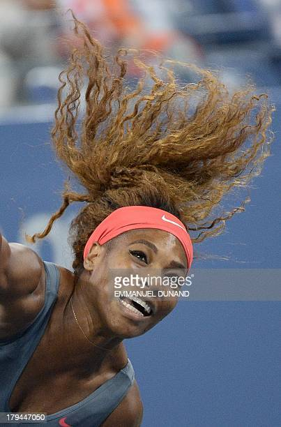 Tennis player Serena Williams plays a points against Spain's Carla Suarez Navarro during their 2013 US Open women's singles match at the USTA Billie...