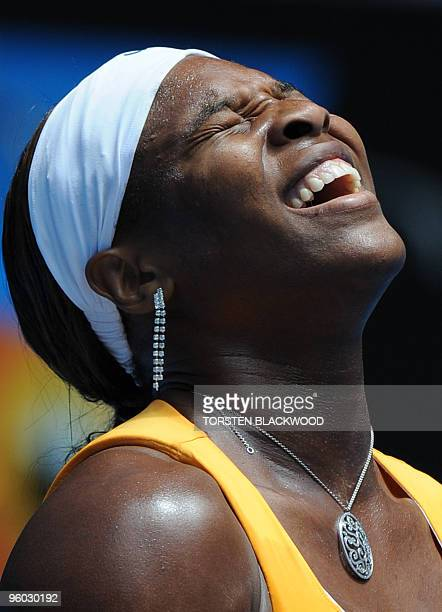 Tennis player Serena Williams reacts during her third round women's singles match against Spanish opponent Carla Suarez Navarro at the Australian...