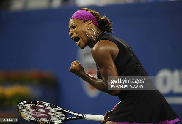 Tennis player Serena Williams reacts to a point to Italy's Flavia Pennetta during their quarterfinals match of the 2009 US Open at the USTA Billie...