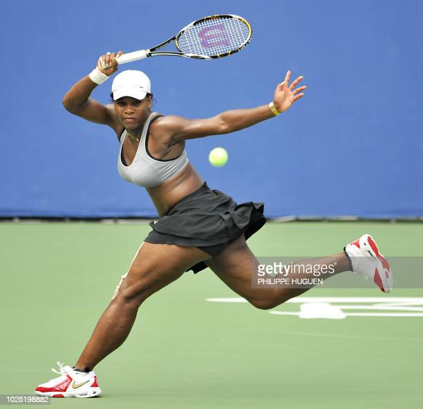 US tennis player Serena Williams returns the ball during a training session at the Olympic Green tennis court in Beijing on August 9 2008 a day...