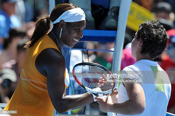 US tennis player Serena Williams shakes hands with Spanish opponent Carla Suarez Navarro after victory in her third round women's singles match at...