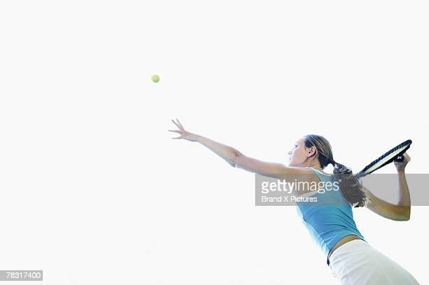 Tennis player serving