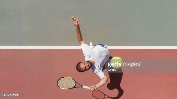 tennis player serving - tennis player stock pictures, royalty-free photos & images