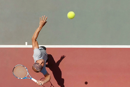 Tennis Player Serving 961759242