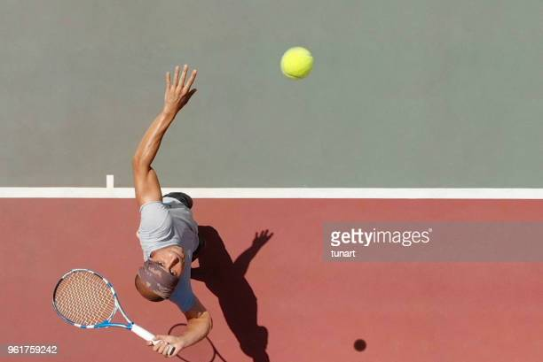 tennis player serving - taking a shot sport stock pictures, royalty-free photos & images