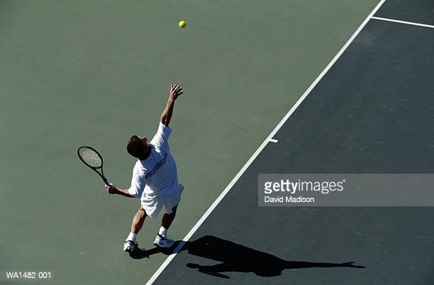 tennis player serving - サーブを打つ ストックフォトと画像