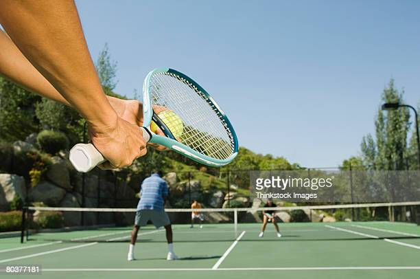 tennis player serving tennis ball - doubles stock photos and pictures