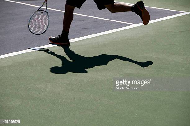 tennis player shadows - indian wells california stock pictures, royalty-free photos & images