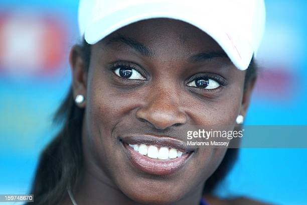 Tennis player Sloane Stephens makes a tshirt with her name on it at the Australian Open shop during day seven of the 2013 Australian Open at...