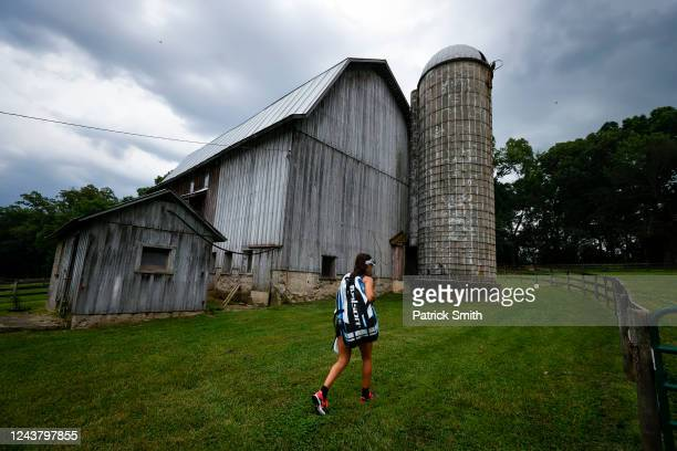 Tennis player Sophie Chang of the United States walks to a barn where she works out off of the tennis court at New Wood Farm her grandmother's farm...