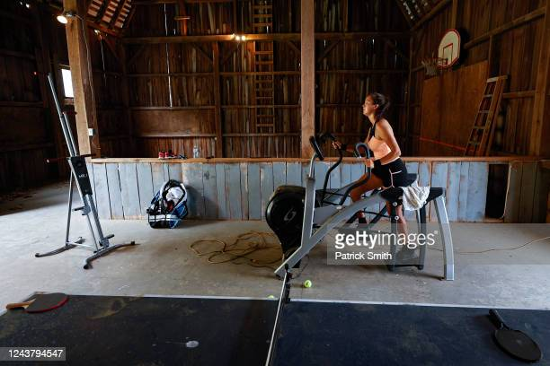 Tennis player Sophie Chang of the United States works out on an elliptical inside a barn at New Wood Farm her grandmother's farm on June 3 2020 in...