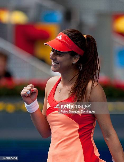 Tennis player Sorana Cirstea of Romania reacts after her victory against Marion Bartoli of France during the first day of the WTA Mutua Madrilena...