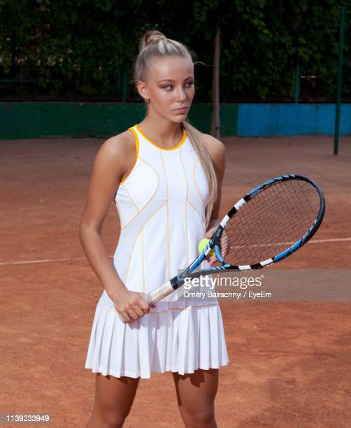 tennis player standing in court - tennis player stock pictures, royalty-free photos & images