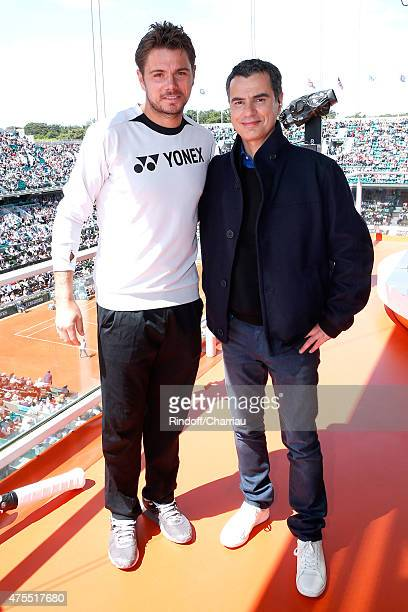 Tennis Player Stanislas Wawrinka and Sports journalist Laurent Luyat pose at France Television french chanel studio during the 2015 Roland Garros...