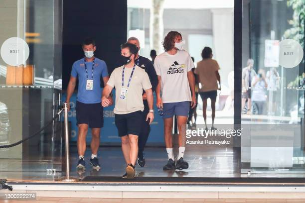Tennis player Stefanos Tsitsipas is seen walking out of the Grand Hyatt hotel on February 04, 2021 in Melbourne, Australia. Victoria has reintroduced...