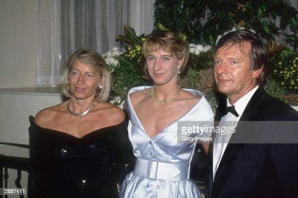 Tennis Player Steffi Graf of Germany poses with her parents Heidi and Peter Graf during the Wimbledon Ball in Wimbledon England