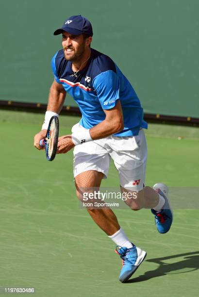 Tennis player Steve Johnson heads for the net during a match at the Oracle Challenger Series tennis tournament played on January 30, 2020 at the...