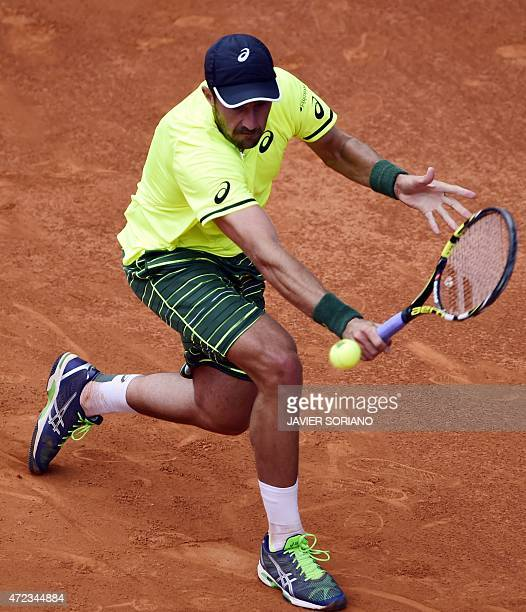 US tennis player Steve Johnson returns a ball to Spanish tennis player Rafael Nadal during the Madrid Open tournament at the Caja Magica sports...