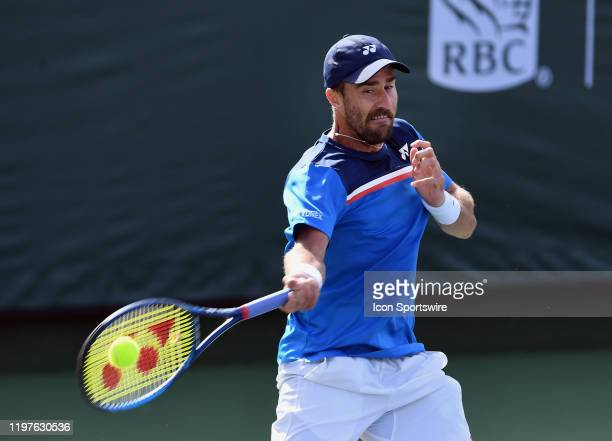 Tennis player Steve Johnson returns the ball during a match at the Oracle Challenger Series tennis tournament played on January 30, 2020 at the...