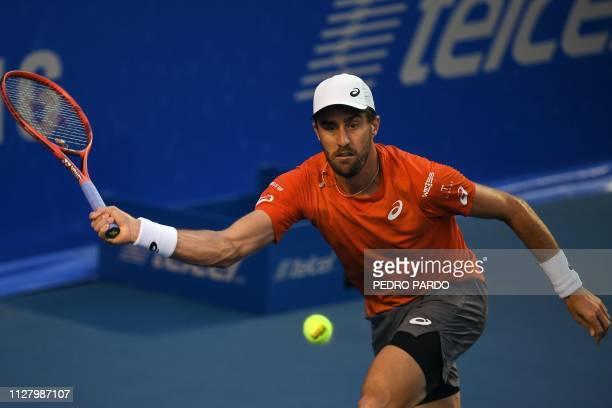 Tennis player Steve Johnson returns the ball to Swiss tennis player Stan Wawrinka during their Mexico ATP 500 Open men's singles tennis match in...