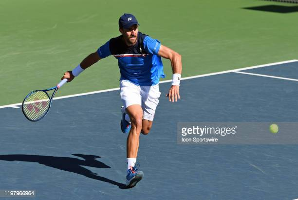 Tennis player Steve Johnson runs towards the net to return a shot in a semifinals match played during the Oracle Challenger Series tennis tournament...