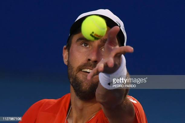 US tennis player Steve Johnson serves to Swiss tennis player Stan Wawrinka during their Mexico ATP 500 Open men's singles tennis match in Acapulco...