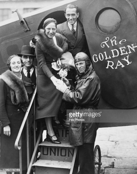 Tennis player Suzanne Lenglen of France boards the French airline Air Union Golden Ray Rayon d'Or twin engined biplane passenger and mail airliner...