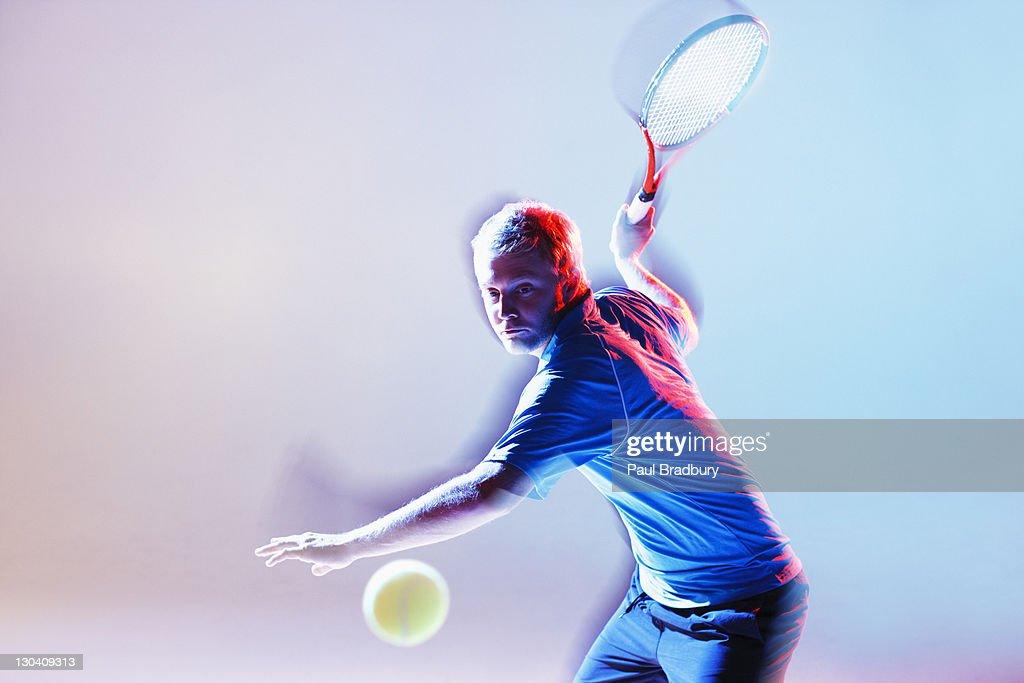 Tennis player swinging racket : Stock Photo