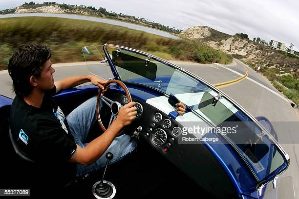 ATP tennis player Taylor Dent drives his Ford Cobra Kit Car through the Upper Newport Bay Regional Park on September 9 2005 in Newport Beach...