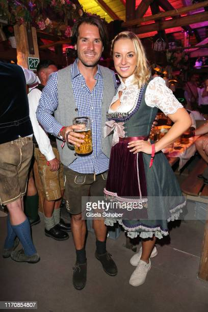 """Tennis player Thomas Mario """"Tommy"""" Haas and Sabine Lisicki during the Oktoberfest 2019 at Theresienwiese on September 24, 2019 in Munich, Germany."""