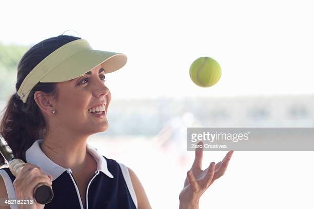 Tennis player tossing ball
