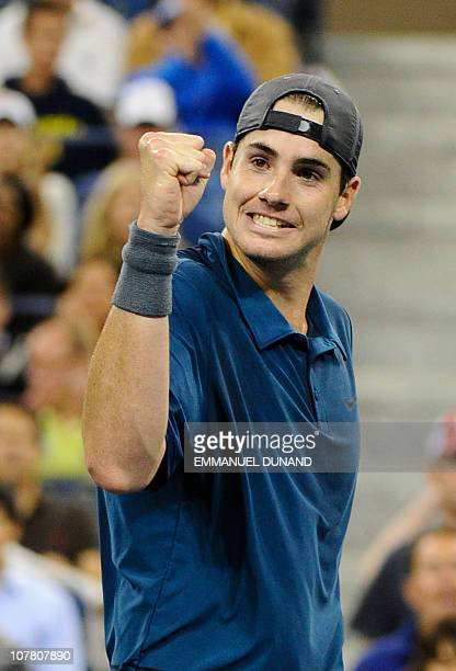 US tennis player US John Isner reacts after winning the second set against Russian tennis player Mikhail Youzhny during their third round match at...