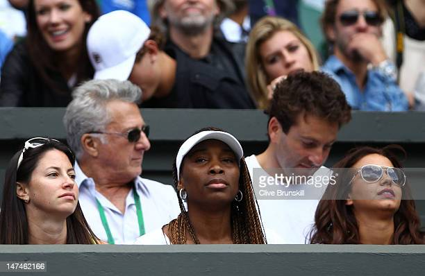 Tennis player Venus Williams Actor Dustin Hoffman and tennis player Justin Gimelstob attend the Ladies' Singles third round match Serena Williams of...