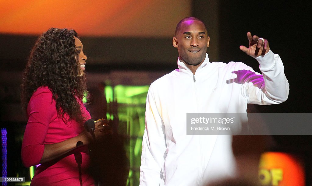 Tennis player Venus Williams (L) and Los Angeles Laker Kobe Bryant speak during the First Annual Cartoon Network's 'Hall of Game' award show at the Barker Hanger on February 21, 2011 in Santa Monica, California.