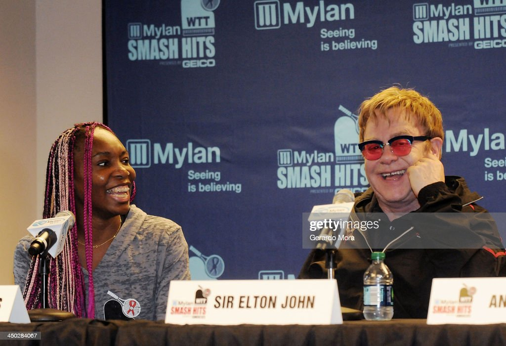 Tennis player Venus Williams (L) and singer Sir Elton John smile during the press conference for Mylan World TeamTennis at ESPN Wide World of Sports Complex on November 17, 2013 in Lake Buena Vista, Florida.