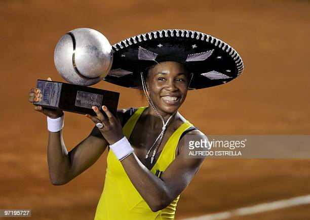 Tennis player Venus Williams celebrates with her trophy after her victory over Slovakian tennis player Polona Hercog, during the final of the WTA...