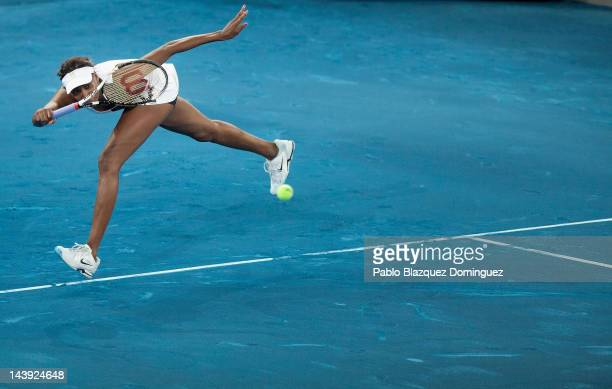 Tennis player Venus Williams of USA returns the ball to Simona Halep of Romania during the first day of the WTA Mutua Madrilena Madrid Open Tennis on...