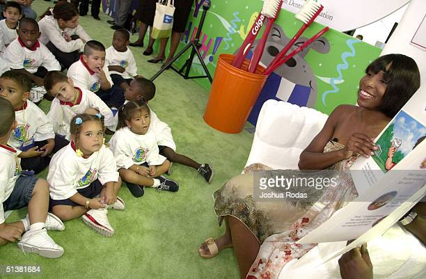 Tennis player Venus Williams reads about the importance of maintaining good oral health habits to Orange County Head Start children October 1 2004 in...