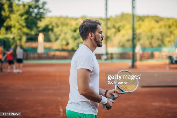 tennis player waiting for the ball - human body part stock pictures, royalty-free photos & images