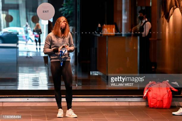 Tennis player waits for transport at the Grand Hyatt hotel in Melbourne on February 4 as preparations for the Australian Open were thrown into chaos...
