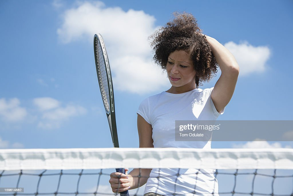 Tennis player with racket on court : ストックフォト