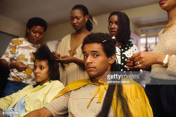 Tennis player Yannick Noah at the hairdressers.