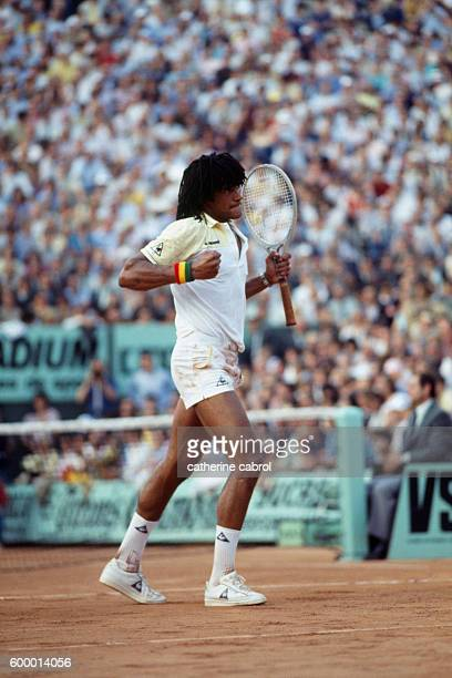 Tennis player Yannick Noah competes in the Roland Garros French Open in 1983.