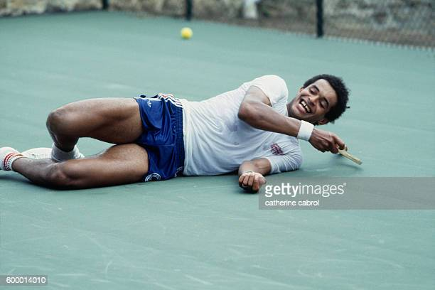 Tennis player Yannick Noah on vacation in the countryside.