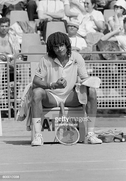 Tennis player Yannick Noah takes a break during the 1983 Monte-Carlo tennis championships.