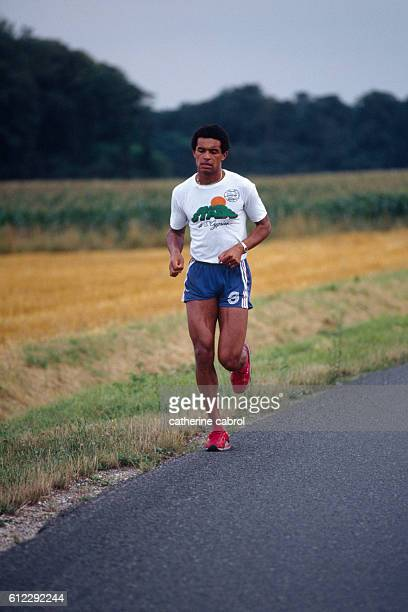 Tennis player Yannick Noah trains in the countryside.