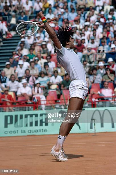 Tennis player Yannick Noah wins his match at the 1983 Monte-Carlo tennis championships.