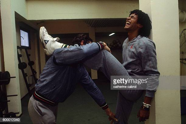 Tennis player Yannick Noah with his coach.