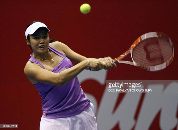 Tennis player Yung Jan Chan of Taipei plays a shot against Daniela Hantuchova of Slovakia during a quarter final round match of the Sunfeast Open...