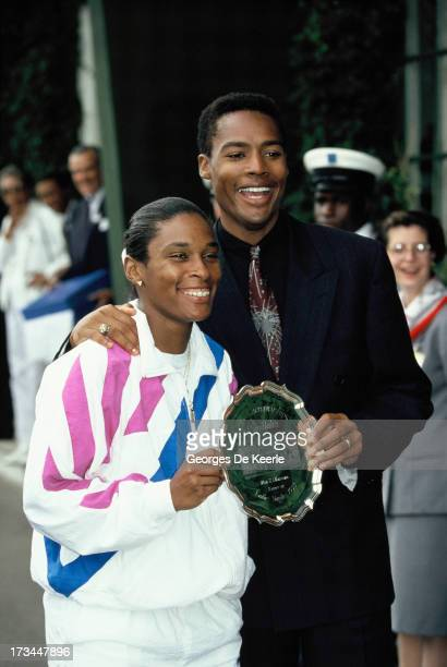 Tennis player Zina Garrison and her husband Willard Jackson pose with her trophy after getting 2nd place at Women's Singles at the Wimbledon...